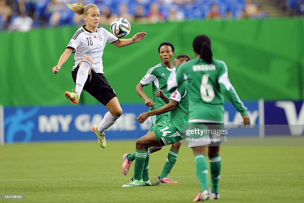 <a gi-track='captionPersonalityLinkClicked' href=/galleries/search?phrase=Lena+Petermann&family=editorial&specificpeople=4620316 ng-click='$event.stopPropagation()'>Lena Petermann</a> of Germany jumps to kick the ball in mid-air in front of Osarenoma Igbinovia of Nigeria during the FIFA Women's U-20 Final at Olympic Stadium on August 24, 2014 in Montreal, Quebec, Canada. Germany defeated Nigeria 1-0 in overtime.