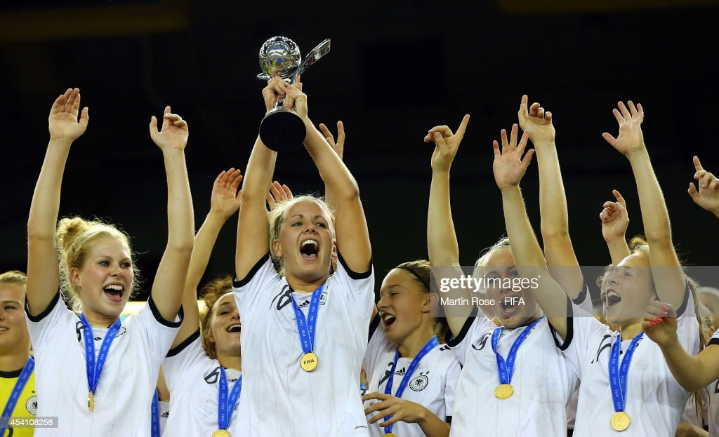 <a gi-track='captionPersonalityLinkClicked' href=/galleries/search?phrase=Lena+Petermann&family=editorial&specificpeople=4620316 ng-click='$event.stopPropagation()'>Lena Petermann</a> of Germany lifts the trophy after the FIFA U-20 Women's World Cup 2014 final match between Nigeria and Germany at Olympic Stadium on August 24, 2014 in Montreal, Canada.