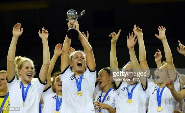 Lena Petermann of Germany lifts the trophy after the FIFA U20 Women's World Cup 2014 final match between Nigeria and Germany at Olympic Stadium on...