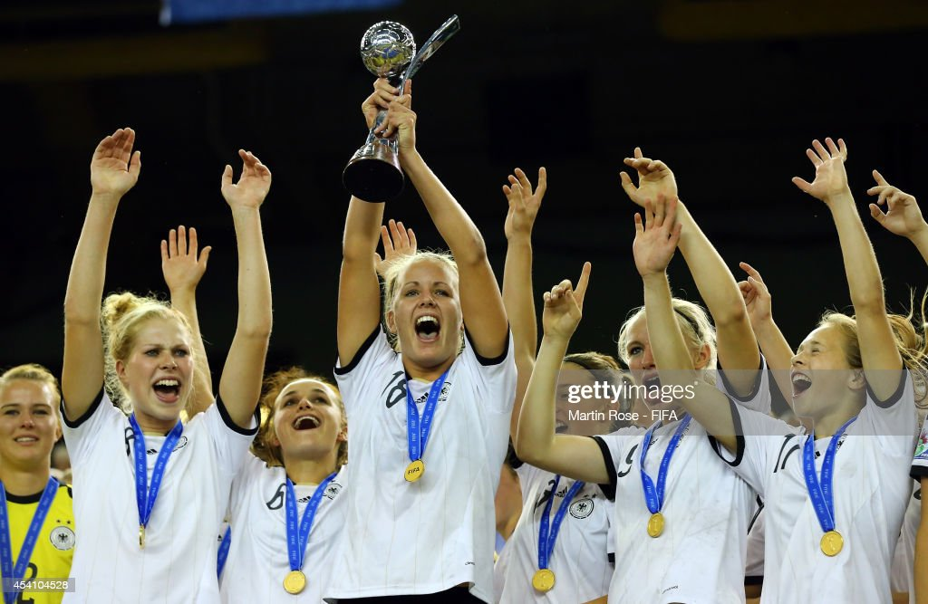 <a gi-track='captionPersonalityLinkClicked' href=/galleries/search?phrase=Lena+Petermann&family=editorial&specificpeople=4620316 ng-click='$event.stopPropagation()'>Lena Petermann</a> of Germany lifts the trophy after winning the FIFA U-20 Women's World Cup 2014 final match between Nigeria and Germany at Olympic Stadium on August 24, 2014 in Montreal, Canada.