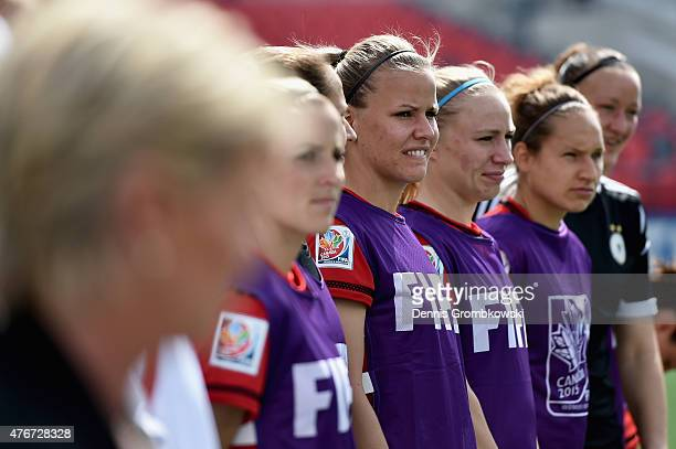 Lena Petermann of Germany looks on as the national anthems are played prior to the FIFA Women's World Cup Canada 2015 Group B match between Germany...