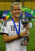 Lena Petermann of Germany poses after winning the FIFA U20 Women's World Cup Canada 2014 final match between Nigeria and Germany at Olympic Stadium...