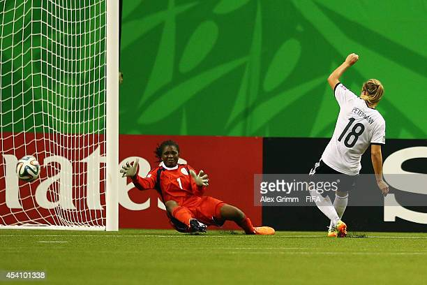 Lena Petermann of Germany scores her team's first goal against goalkeeper Sandra Chiichii of Nigeria during the FIFA U20 Women's World Cup Canada...