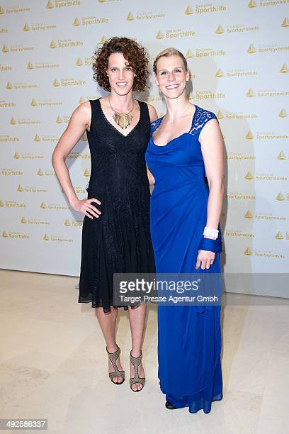 Lena Schoeneborn and guest attend the awarding of the 'Goldene Sportpyramide 2014' at Hotel Adlon on May 16 2014 in Berlin Germany