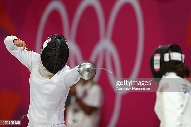 Lena Schoneborn of Germany competes againstSuzanne Stettinius of the United States during the fencing in the Women's Modern Pentathlon on Day 16 of...