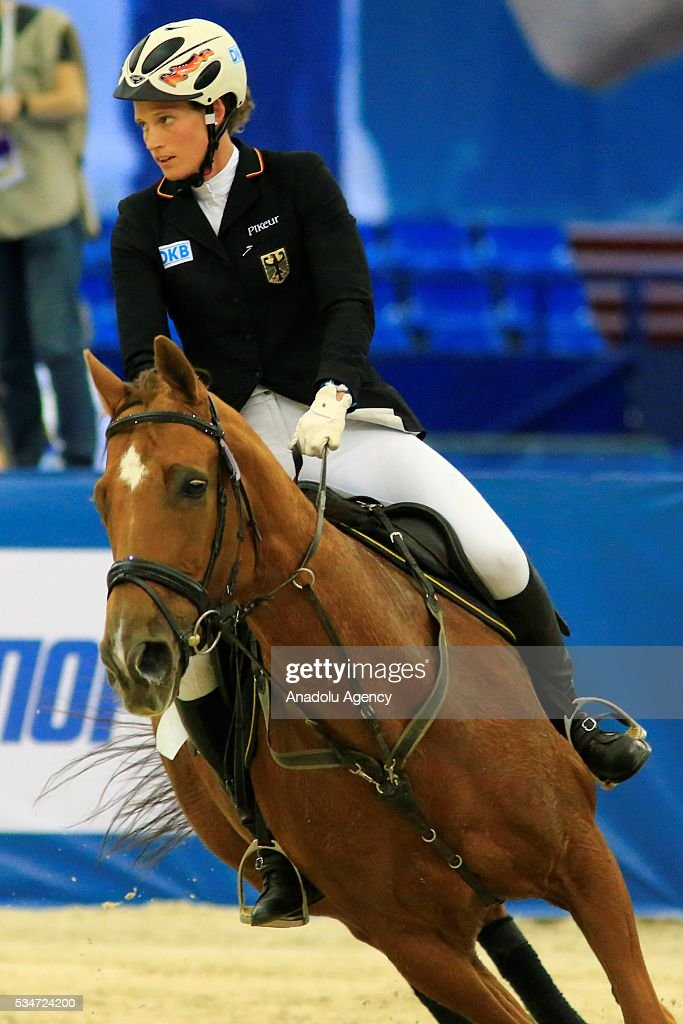 Lena Schoneborn of Germany with horse Doblest are seen during the riding discipline of the women's final at the modern pentathlon world championships in Moscow, Russia, on May 27, 2016.