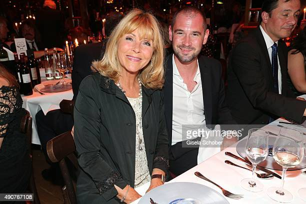 Lena Valaitis and her son Don Juessen during Ralph Siegel's 70th birthday party at Schuhbeck's Teatro on September 30 2015 in Munich Germany