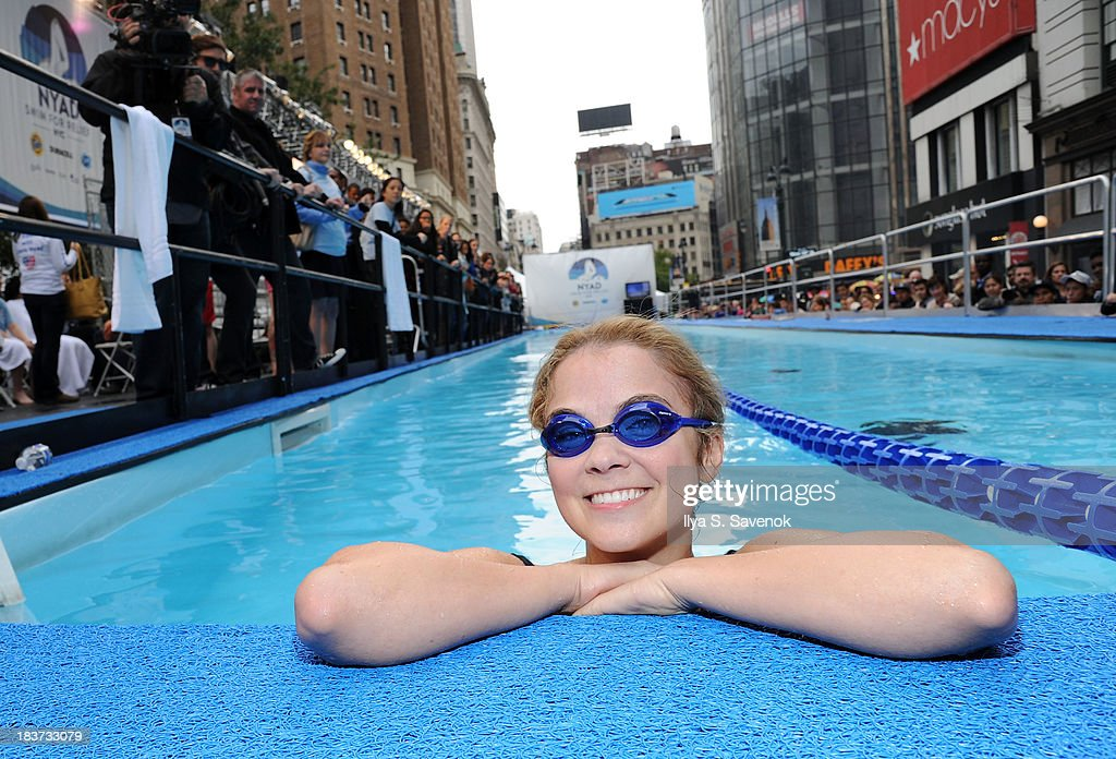 <a gi-track='captionPersonalityLinkClicked' href=/galleries/search?phrase=Lenay+Dunn&family=editorial&specificpeople=7040009 ng-click='$event.stopPropagation()'>Lenay Dunn</a> swims during 'Swim for Relief' Benefiting Hurricane Sandy Recovery - Day 2 at Herald Square on October 9, 2013 in New York City.