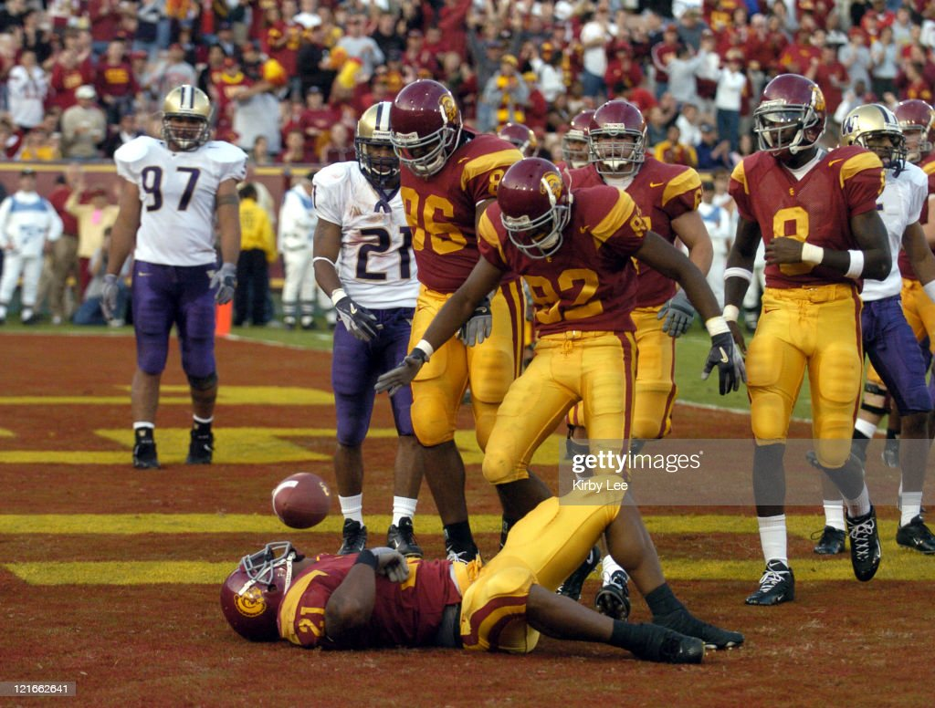 LenDale White is congratulated by Dominique Byrd (86) and Chris McFoy (82) after scoring on a 3-yard run in the third quarter of 38-0 victory over Washington in Pacific-10 Conference football game at the Los Angeles Memorial Coliseum on Saturday, Oct. 23, 2004.