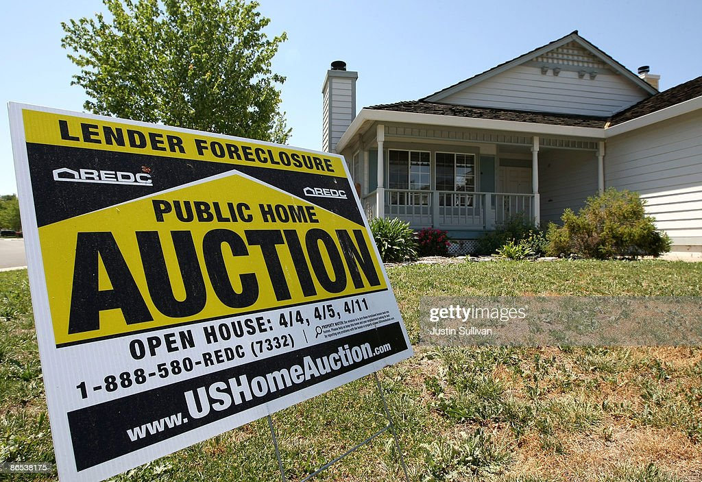 A lender foreclosure auction sign is posted in front of a foreclosed home May 7, 2009 in Antioch, California. A study of government data on subprime loans by the Center for Public Integrity showed that 56 percent of the $1.38 trillion in subprime mortgages originated from 15 lenders in California between 2005 and 2007.