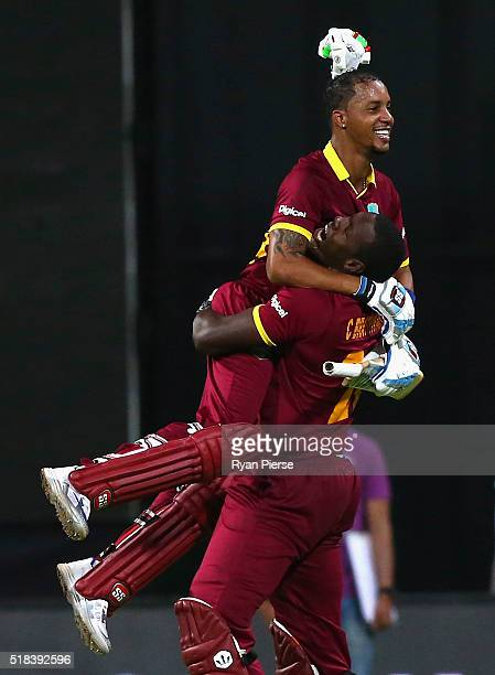 Lendl Simmons and Carlos Brathwaite of the West Indies celebrate victory during the ICC World Twenty20 India 2016 Semi Final match between West...