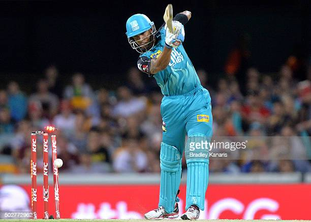 Lendl Simmons of the Heat is bowled off the bowling of Shaun Tait of the Hurricanes during the Big Bash League match between the Brisbane Heat and...