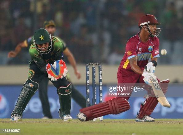Lendl Simmons of the West Indies bats as Kamran Akmal of Pakistan looks on during the ICC World Twenty20 Bangladesh 2014 match between West Indies...