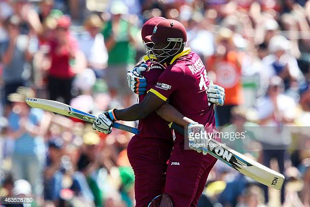 Lendl Simmons of the West Indies is congratulated on his century by teammate Andre Russell during the 2015 ICC Cricket World Cup match between the...