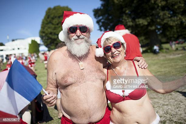 Lene Otzen and George Otzen from Souillac in France both respectively have been acting as the Santa Claus and pixie mother for 13 years pose on July...