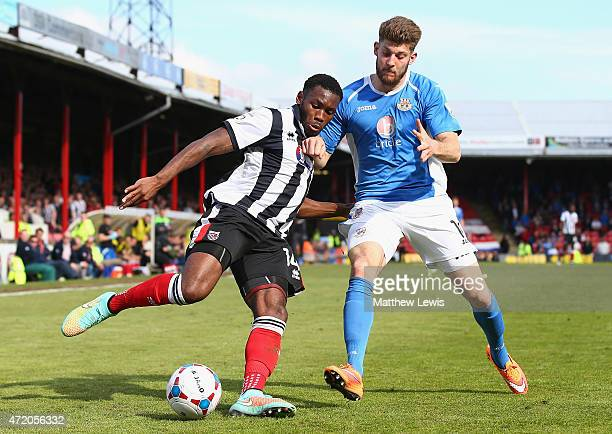 Lenell JohnLewis of Grimsby Town and Will Evans of Eastleigh challenge for the ball during the Vanarama Football Conference League match between...