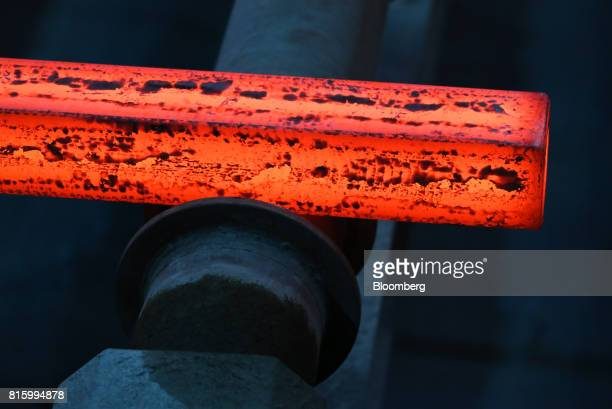 A length of red hot steel moves along the production line in the cooling shop at the Oskol Elektrometallurgical Plant steel mill operated by...