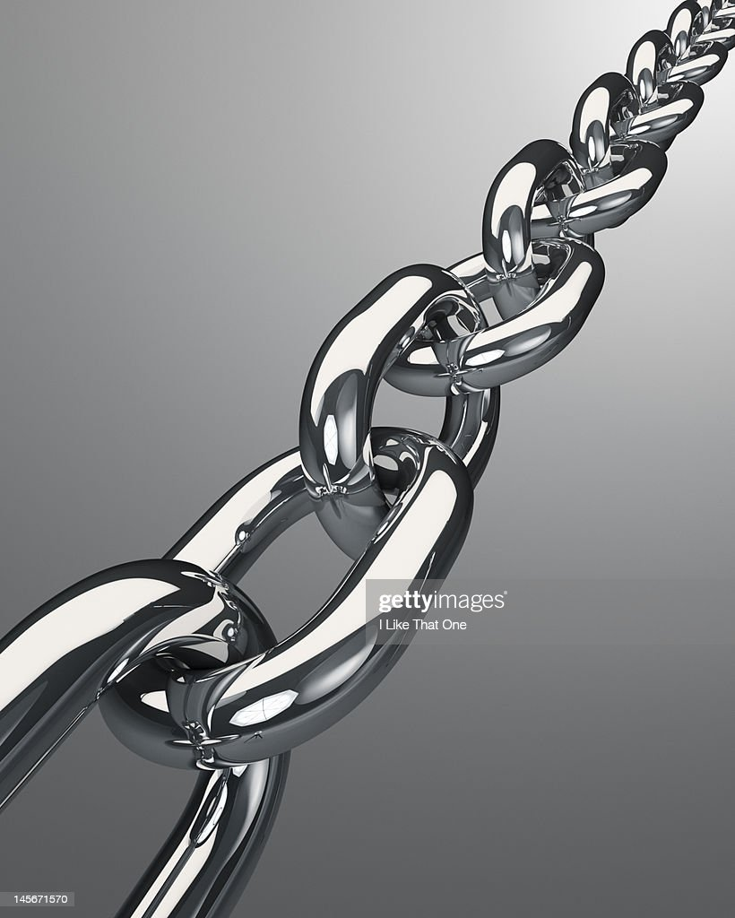Length of steel chain receding into distance : Stock Photo