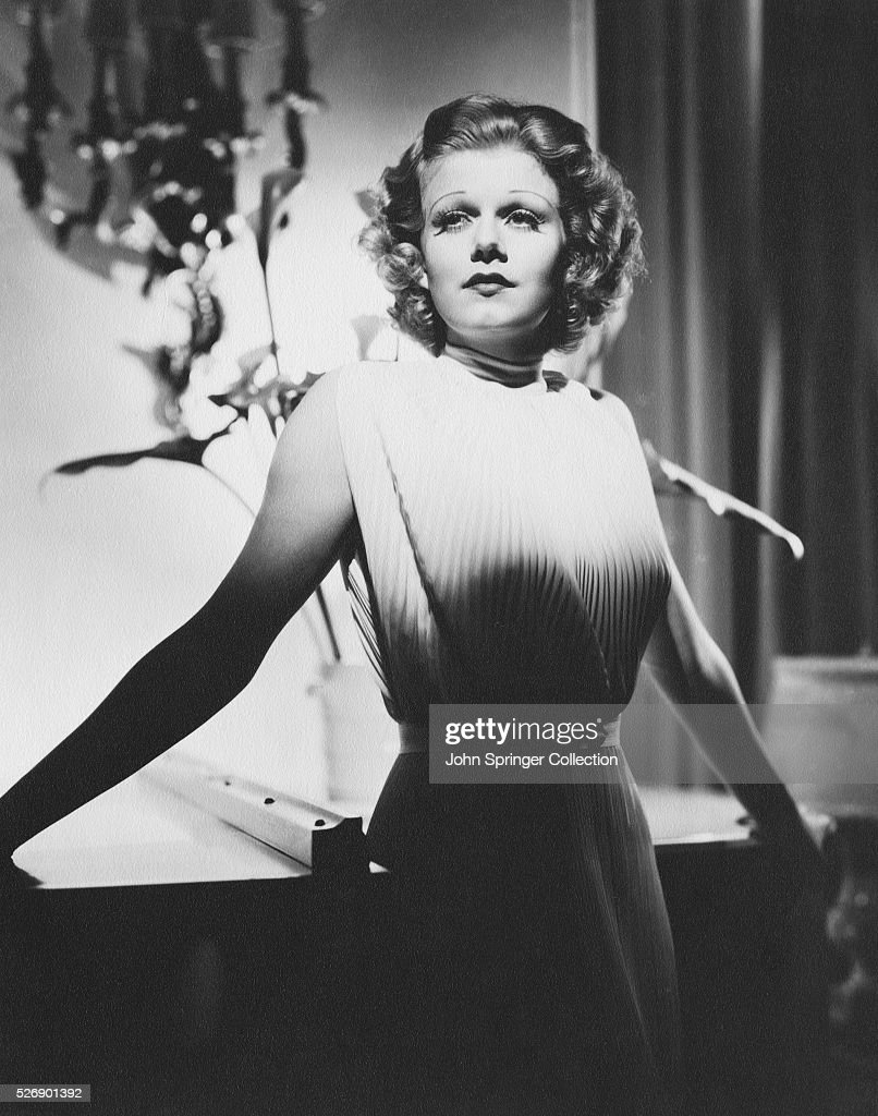 3/4 length photo of American actress Jean Harlow posing with her arms out Ca 1930s