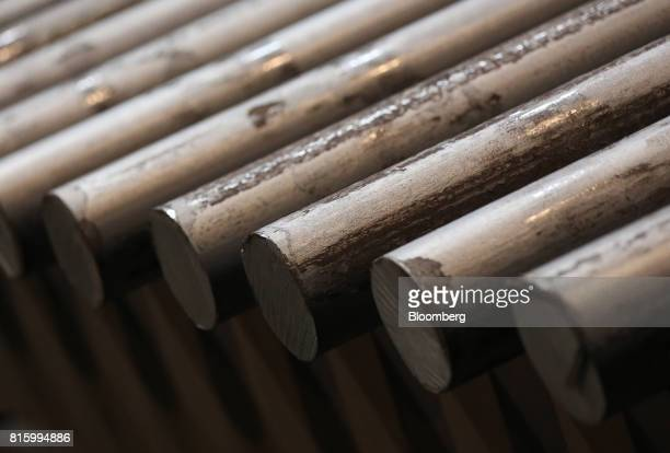 Lengths of rolled steel rods sit in storage ahead of distribution at the Oskol Elektrometallurgical Plant steel mill operated by...