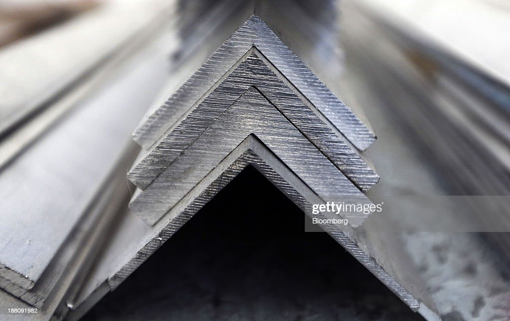 Lengths of shaped aluminium sit stored ahead of use in the warehouse at Metal Supermarkets in Southampton, U.K., on Friday, Nov. 15, 2013. The Bank of England sees gross domestic product rising 0.9 percent this quarter before easing in the early part of 2014, according to its new projections. Photographer: Chris Ratcliffe/Bloomberg via Getty Images