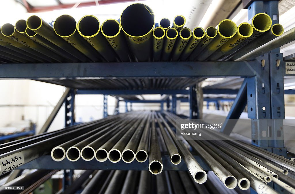 Lengths of steel pipes sit on storage racking in the warehouse at Metal Supermarkets in Southampton, U.K., on Friday, Nov. 15, 2013. The Bank of England sees gross domestic product rising 0.9 percent this quarter before easing in the early part of 2014, according to its new projections. Photographer: Chris Ratcliffe/Bloomberg via Getty Images