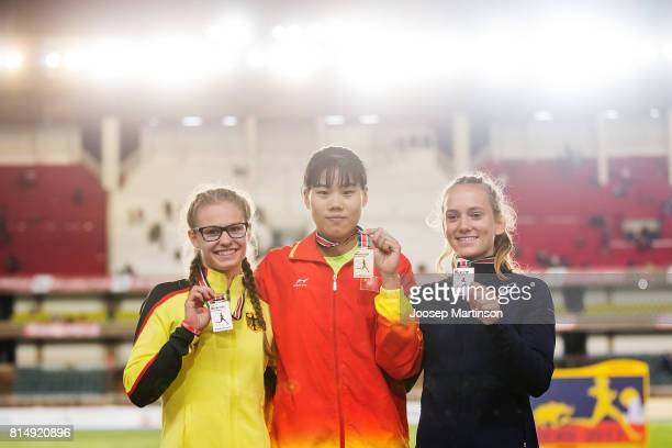 Leni Freyja Wildgrube of Germany Chunge Niu of China and Anna Airault of France pose during the girls pole vault medal ceremony during day 4 of the...