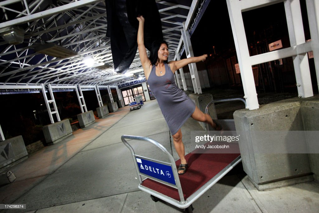 Leni Manaa-Hoppenworth, of Chicago, poses on a luggage cart while Paola Bordon (not pictured), also from Chicago, takes photos of her as they pass time following the learning that their flight home was cancelled after Southwest Airlines Flight 345's landing gear collapsed shortly after landing on runway 4 at LaGuardia Airport in the Queens borough of New York City. The flight, which originated in Nashville, landed at 5:45 p.m. and was carrying 149 passengers and crew. A reported 10 people were injured.