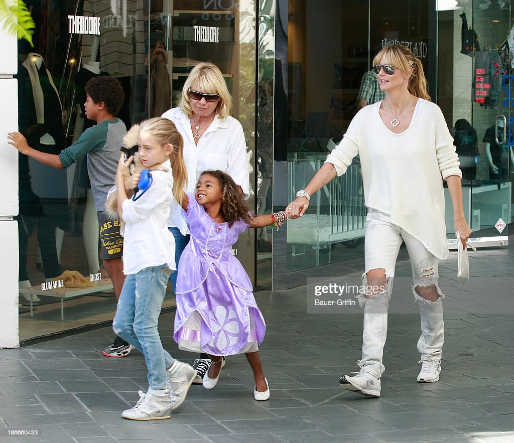 Leni Samuel, Lou Samuel and <a gi-track='captionPersonalityLinkClicked' href=/galleries/search?phrase=Heidi+Klum&family=editorial&specificpeople=178954 ng-click='$event.stopPropagation()'>Heidi Klum</a> are seen on November 2, 2013 in Los Angeles, California.