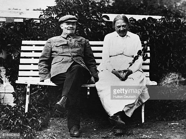 Lenin and his wife Krupskaya sit together on a bench
