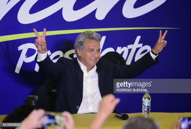 Lenin Moreno the presidential candidate of the governing Alianza PAIS party makes the 'V for victory' sign to supporters at a hotel in Quito shortly...