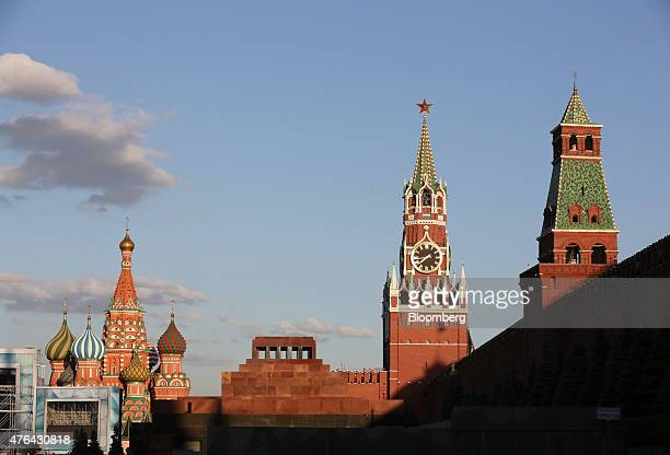 Lenin's mausoleum center stands on Red Square near the Kremlin right and St Basil's cathedral left on Red Square in Moscow Russia on Monday June 8...