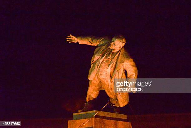Lenin's statue on Kharkiv central square is toppled on September 28 2014 Nationalists supported by a cheering crowd torn down Lenin's statue in...