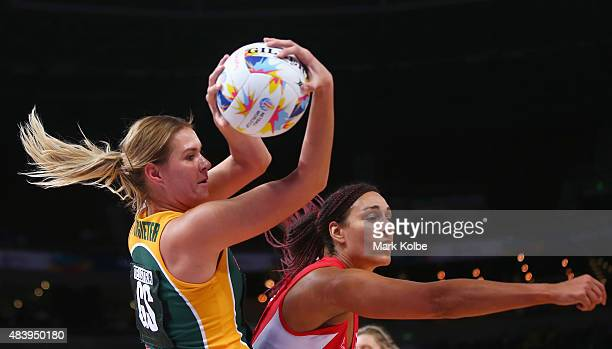 Lenize Potgieter of South Africa wins the ball over Geva Mentor of England during the 2015 Netball World Cup match between England and South Africa...