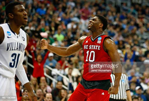 Lennard Freeman of the North Carolina State Wolfpack celebrates after making a shot in front of Dylan Ennis of the Villanova Wildcats in the second...