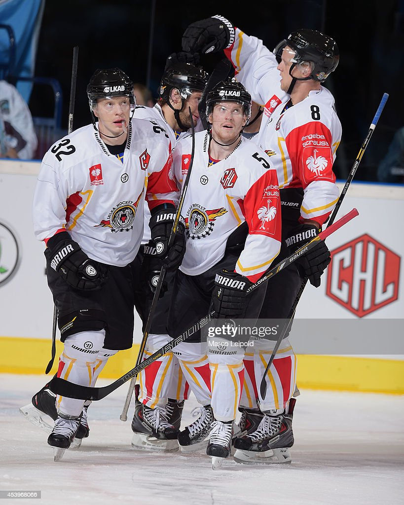 Lennart Petrell #32 of Lulea Hockey celebrates with team-mates after scoring a goal during the Champions Hockey League group stage game between Hamburg Freezers and Lulea HF on August 22, 2014 in Hamburg, Germany.