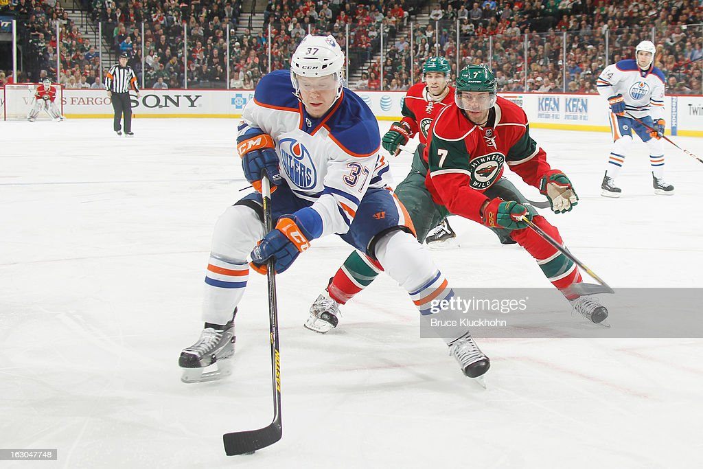 Lennart Petrell #37 of the Edmonton Oilers handles the puck with <a gi-track='captionPersonalityLinkClicked' href=/galleries/search?phrase=Matt+Cullen&family=editorial&specificpeople=536122 ng-click='$event.stopPropagation()'>Matt Cullen</a> #7 of the Minnesota Wild defending during the game on March 3, 2013 at the Xcel Energy Center in Saint Paul, Minnesota.