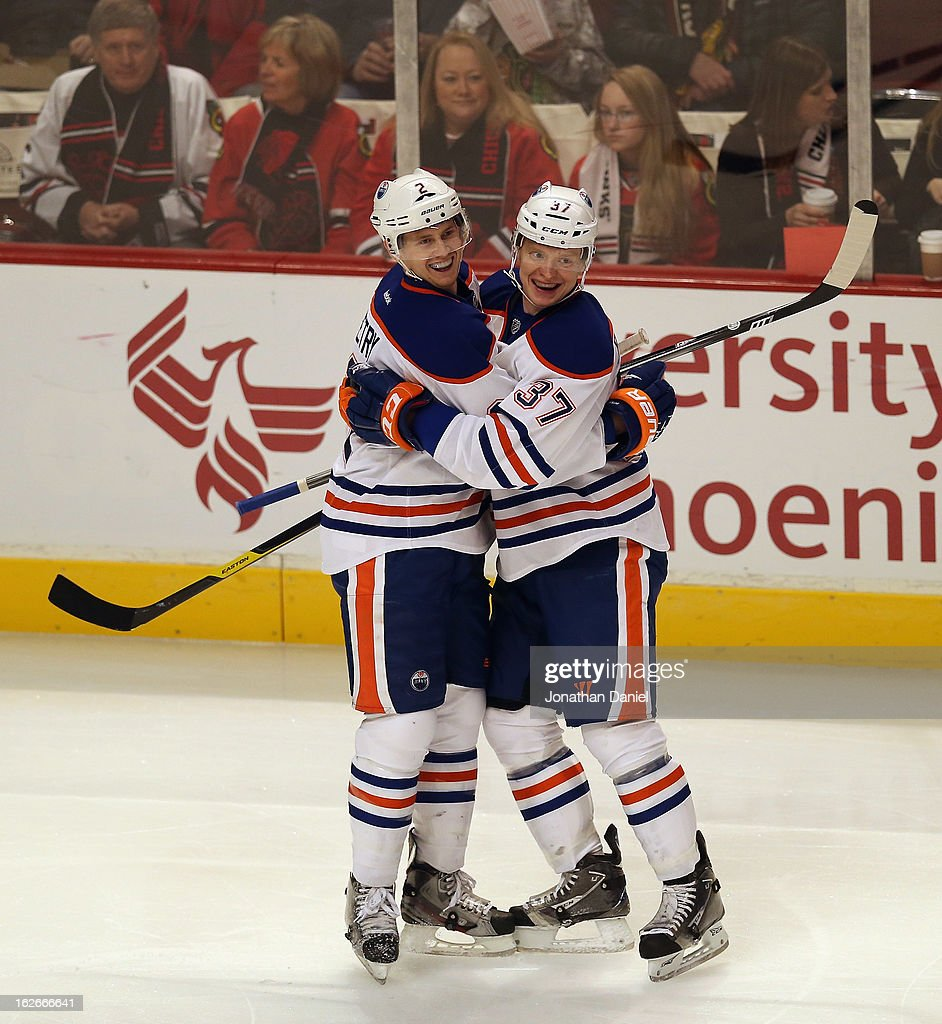Lennart Petrell #37 of the Edmonton Oilers hugs teammate Jeff Petry #2 after Petry scored a short-handed goal in the 1st period against the Chicago Blackhawks at the United Center on February 25, 2013 in Chicago, Illinois.