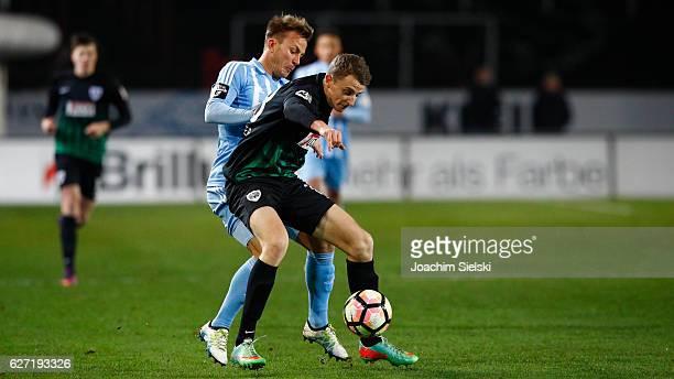 Lennart Stoll of Muenster challenges Fabian Stenzel of Chemnitz during the Third League match between Preussen Muenster and Chemnitzer FC at...