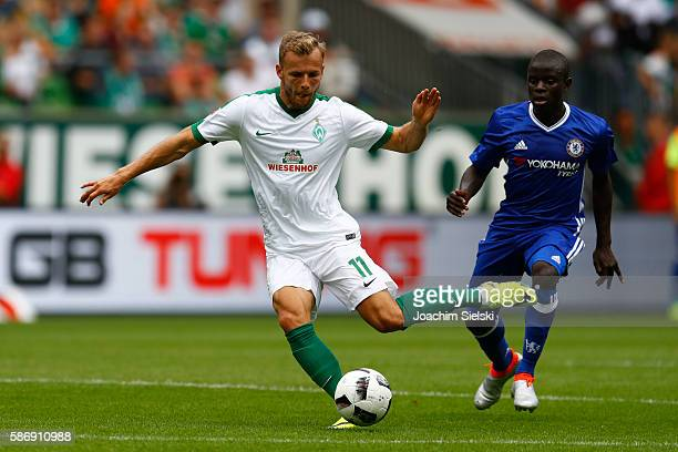 Lennart Thy of Bremen challenges N Golo Kante of Chelsea during the preseason friendly match between Werder Bremen and FC Chelsea at Weserstadion on...