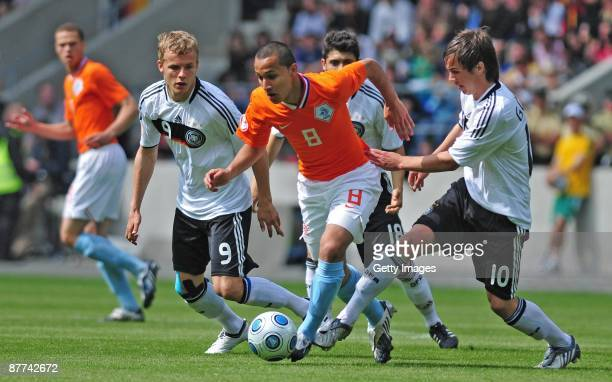 Lennart Thy of Germany Mario Goetze of Germany and Osama Rashid of Netherlands battle for the ball during the Uefa U17 European Championship Final...