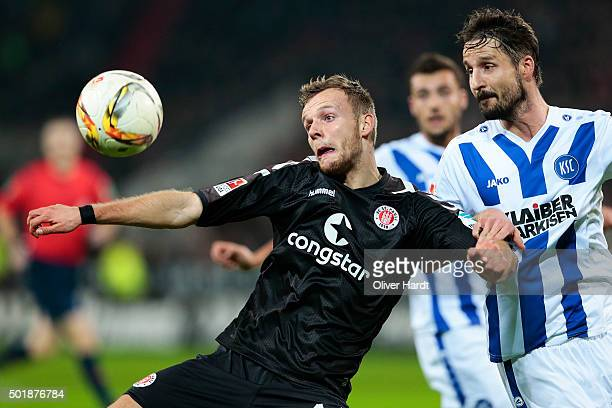 Lennart Thy of Pauli and Martin Stoll of Karlsruhe compete for the ball during the Second Bundesliga match between FC St Pauli and Karlsruher SC at...