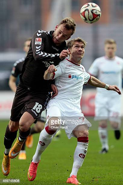 Lennart Thy of Pauli and Michael Schulze of Kaiserslautern compete for the ball during the Second Bundesliga match between FC St Pauli and 1 FC...