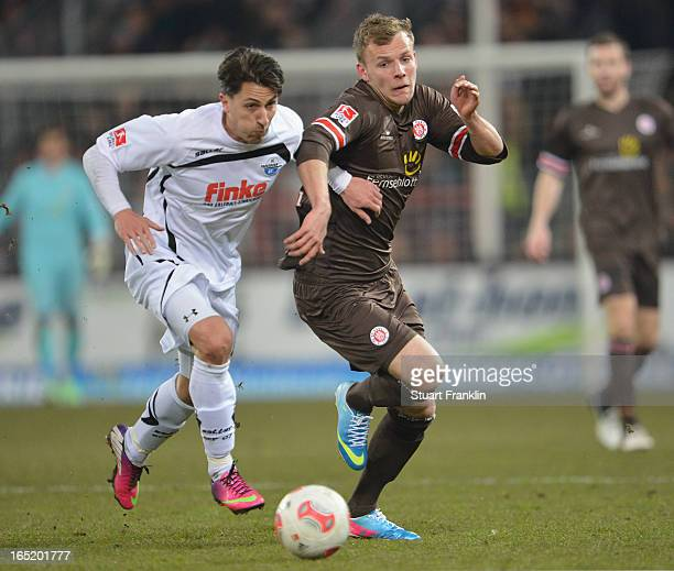 Lennart Thy of Pauli is challenged by Jens Wemmer of Paderborn during the second Bundesliga match between FC St Pauli and SC Paderborn 07 at...