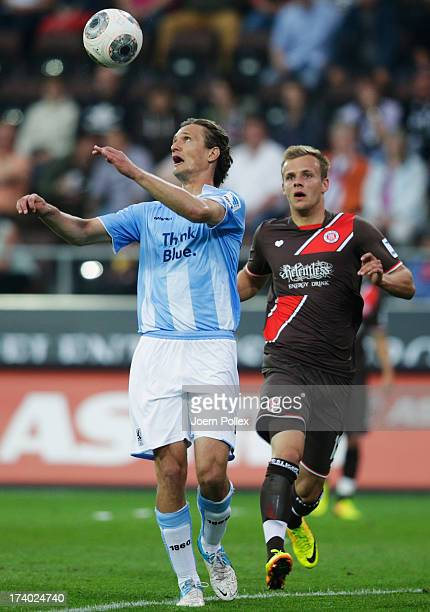 Lennart Thy of St Pauli and Kai Buelow of Muenchen compete for the ball during the Second Bundesliga match between FC St Pauli and 1860 Muenchen at...