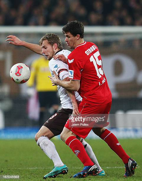 Lennart Thy of St Pauli and Tobias Strobl of Koeln compete for the ball during the Second Bundesliga match between FC St Pauli and 1 FC Koeln at...