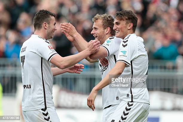 Lennart Thy of St Pauli celebrates after scoring their second goal with his teammates during the Second Bundesliga match between FC St Pauli and VfL...