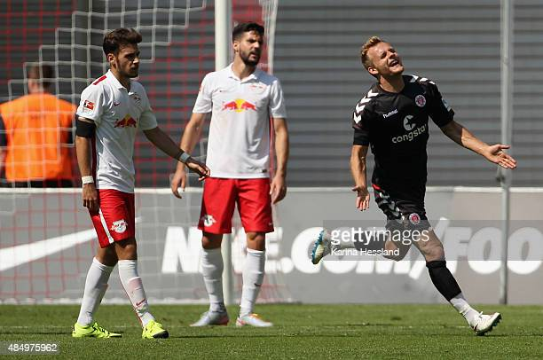 Lennart Thy of St Pauli celebrates the opening goal during the Second League match between RB Leipzig and FC StPauli at RedBull Arena on August 23...