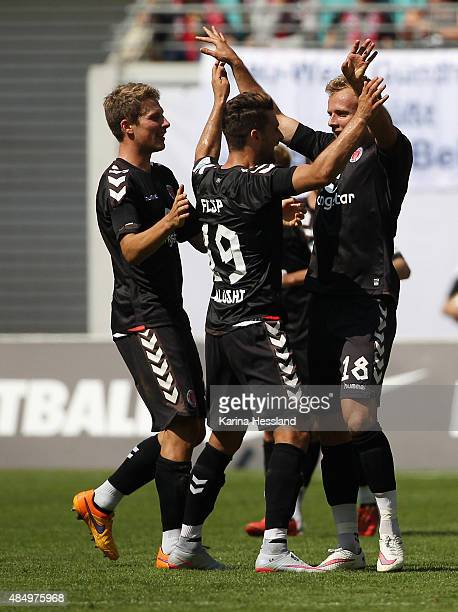 Lennart Thy of St Pauli celebrates the opening goal with teammates during the Second League match between RB Leipzig and FC StPauli at RedBull Arena...
