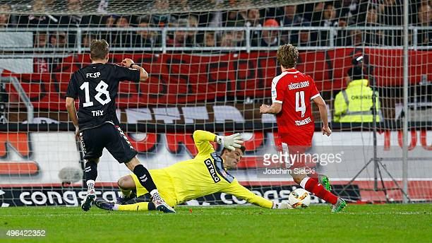 Lennart Thy of St Pauli challenges Michael Rensing and Julian Schauerte of Duesseldorf during the Second Bundesliga match between FC St Pauli and...
